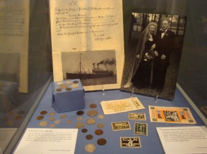 "Emergency Money with family photographs on display in ""Bentheimers in West Michigan"""